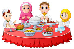 Muslim family pray together before break fasting Stock Photos