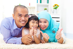 Muslim family. Raised their thumbs up royalty free stock photo