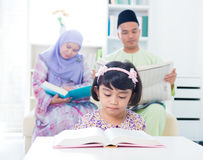 Muslim family reading. Royalty Free Stock Photography