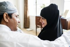 Muslim family relaxing in the home royalty free stock images