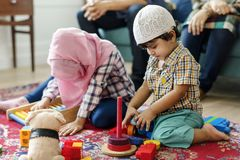 Muslim family relaxing and playing at home stock photography
