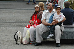 Muslim family resting on the street Royalty Free Stock Images