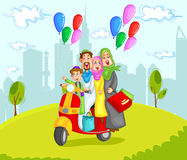 Muslim family riding on scooter Royalty Free Stock Images