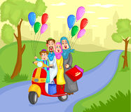 Muslim family riding on scooter Stock Photos