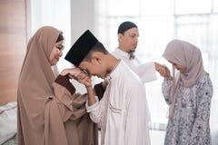 Muslim family shake hand apologizing during the Eid mubarak