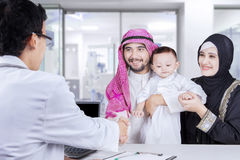 Muslim family shaking hands with a pediatrician Royalty Free Stock Photography