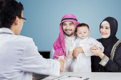 Muslim family shaking hands with pediatrician Royalty Free Stock Photography