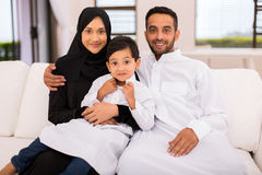 Muslim family sitting couch Stock Photography