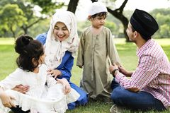 Muslim family spending time at a park stock photography