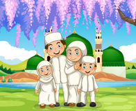 Muslim family standing in the park Royalty Free Stock Image