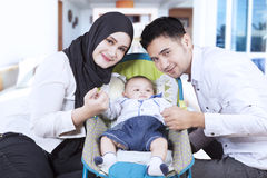Muslim family and their son in stroller Royalty Free Stock Photography