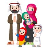 A muslim family with three children are giving the greeting forgiveness of ied mubarak. Illustration of A muslim family with three children are giving the vector illustration