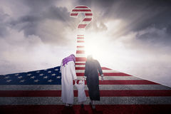 Muslim family with USA flag at highway Royalty Free Stock Photos