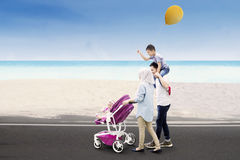 Muslim family walking together on the road Royalty Free Stock Photos