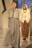 Muslim Fashion Festival 2014. Models showcase designs by Dwi Adi Kusuma on the runway at the 5th Muslims Fashion Festival 2014 show on October 3, 2014 in Stock Image