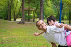 Muslim father and daughter piggyback Royalty Free Stock Image
