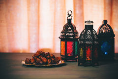 The Muslim feast of the holy month of Ramadan Kareem. Beautiful background with a shining lantern Fanus. Free space for your text Stock Photo
