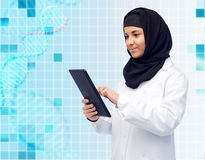 Muslim female doctor in hijab with tablet pc Stock Image
