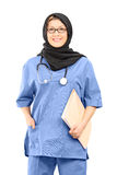Muslim female doctor holding papers Stock Photography