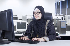 Muslim female entrepreneur works with a computer Stock Photo