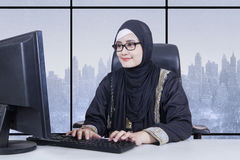 Muslim female entrepreneur works with winter background Stock Photos