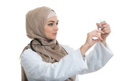 Muslim female medical doctor filling the syringe getting ready for a medical procedure. Royalty Free Stock Image