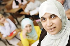 Muslim female teacher in classroom Stock Photography