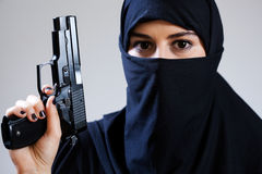 Muslim female terrorist holding handgun Royalty Free Stock Photo