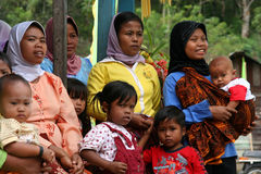 Muslim festival observers. Group of Muslim people, women and children, during muslim festival in Sumatra Royalty Free Stock Images