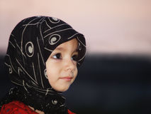 Muslim girl. Wearing the traditional head scarf Stock Image