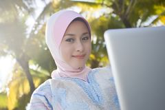 Muslim Girl Are Using Laptop Stock Images