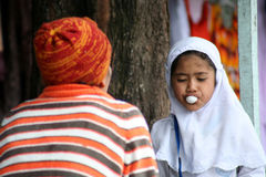Muslim girl chewing gum Stock Image