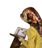Muslim girl in hijab reading Al Quran on a white background Royalty Free Stock Photos