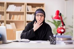 The muslim girl in hijab studying preparing for exams Royalty Free Stock Photography