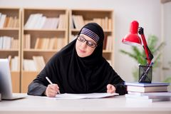 The muslim girl in hijab studying preparing for exams Stock Photo