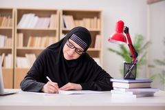 The muslim girl in hijab studying preparing for exams Stock Photography