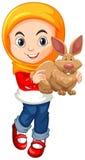 Muslim girl holding brown rabbit Stock Image