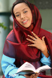 Muslim Girl Holding Qur'an Stock Photography