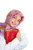 Muslim girl holds holy Koran Stock Photo