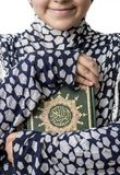 Muslim Girl Huging Holy Book of Quran. A Happy Young Muslim Girl Hugging A Holy Book of Quran stock photos