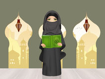 Muslim girl with Islam`s holy book the Koran. Illustration of Muslim girl with Islam`s holy book the Koran Stock Photos