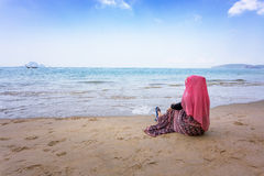 Muslim girl look out the sea Royalty Free Stock Images