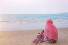 Muslim girl look out the sea Royalty Free Stock Photography