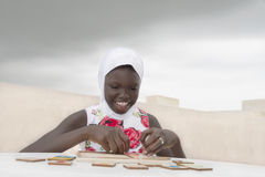 Muslim girl playing on a terrace, ten years old Royalty Free Stock Photography