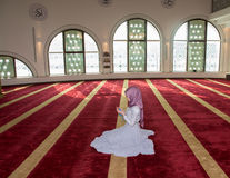 Muslim girl pray in mosque stock photography