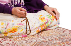 Muslim girl praying at mosque Royalty Free Stock Image