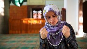 Muslim girl praying Stock Photos