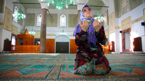 Muslim girl praying Stock Image