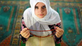 Muslim girl praying Stock Photos