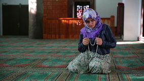Muslim girl praying Stock Photography